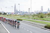Peloton with the Antwerp skyline as a backdrop <br /> <br /> Binckbank Tour 2017 (UCI World Tour)<br /> Stage 7: Essen (BE) > Geraardsbergen (BE) 191km