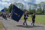 Priddy Friendly Society annual Club Walk Day. Somerset Uk 2019. Members walk around the village behind the Weston Sea Cadets silver band from Weston-super-Mare and the clubs two banners. The oldest banner is solid blue on both sides, while a more recent banner say,  Priddy Friendly Society 1883.<br /> Flag bearer Fred Payne