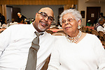 WATERBURY,  CT-041919JS11-Rev. Guy Riddick, associate minister at Grace Baptist Church with his mother Sally Riddick,  at the annual Good Friday fish fry held at Grace Baptist Church in Waterbury. <br />  Jim Shannon Republican American