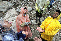 "Leslie Vega,16, left, Outward Bound Adventures guide Andrew Newman, right, and Jonathan Gallardo,16,center, sticking their tongues out to catch raindrops, while camping in the Sierras Golden Trout Wilderness. Profile of Outward Bound Adventures, a nonprofit organization that introduces at-risk urban teens to the therapeutic benefits of time spent in the wilds, there motto is; ""Share the Earth, Challenge a Child"". Known as OBA, the group brought 12 teens, all continuation high school students from the Pico Union and Watts areas of downtown Los Angeles on a 28-mile trek  July 31 - August 9, 2005. OBA annually brings Los Angeles teens into the High Sierra's."