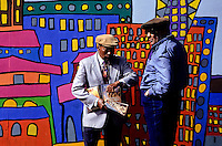 Two black Jehovas Witnesses with The Wach Tower in fron of a painting of San Francisco skyscrapers foto, reise, photograph, image, images, photo,<br /> photos, photography, picture, pictures, urlaub, viaje, vacation, imagen, viagi, stock