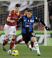 Calcio, ottavi di finale di Coppa Italia: Roma vs Atalanta. Roma, stadio Olimpico, 11 dicembre 2012..AS Roma defender Alessio Romagnoli and Atalanta forward German Gustavo Denis, of Argentina, right, fight for the ball during their Italy Cup last-16 tie football match between AS Roma and Atalanta at Rome's Olympic stadium, 11 december 2012. .UPDATE IMAGES PRESS/Riccardo De Luca