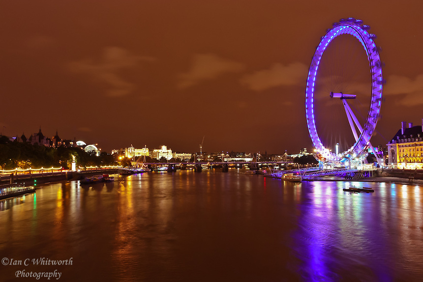 The River Thames at night with the lights of the London Eye