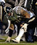 3 December 2006: San Diego Chargers defensive end Igor Olshansky (99) injures his leg in a play against the Buffalo Bills at Ralph Wilson Stadium in Orchard Park, New York. The Charges defeated the Bills 24-21. Mandatory Photo Credit: Ed Wolfstein Photo<br />