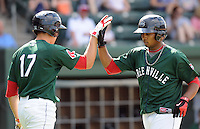 Left fielder Keury De la Cruz (25) of the Greenville Drive, right, is congratulated after hitting a home run by Garin Cecchini (17) in a game against the Rome Braves on May 6, 2012, at Fluor Field at the West End in Greenville, South Carolina. Greenville won, 11-3. (Tom Priddy/Four Seam Images)