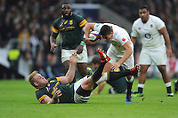 Ben Youngs of England stumbles over Vincent Koch of South Africa during the Old Mutual Wealth Series match between England and South Africa at Twickenham Stadium on Saturday 12th November 2016 (Photo by Rob Munro)