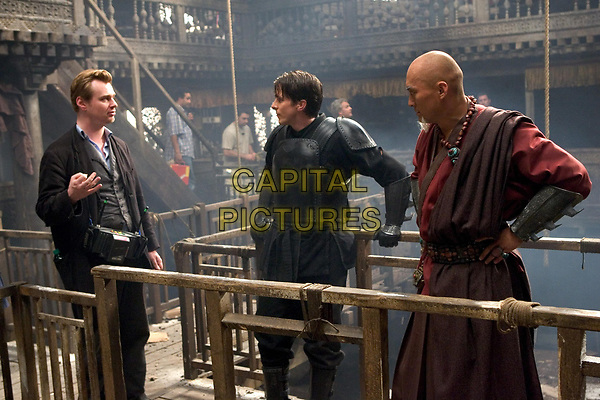 Batman Begins (2005)<br /> Behind the scenes photo of Christian Bale, Christopher Nolan &amp; Ken Watanabe<br /> *Filmstill - Editorial Use Only*<br /> CAP/KFS<br /> Image supplied by Capital Pictures