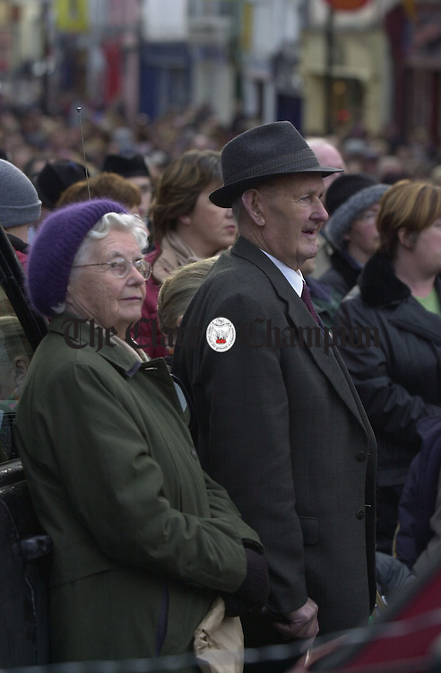 An elderly couple  look on during the Ennis Hospital protest rally. Photograph by John Kelly