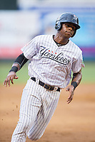 Isiah Gilliam (34) of the Pulaski Yankees hustles towards third base against the Elizabethton Twins at Calfee Park on July 25, 2016 in Pulaski, Virginia.  The Twins defeated the Yankees 6-1.  (Brian Westerholt/Four Seam Images)