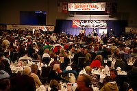 Spectators watch as the Iditarod mushers draw for their starting positions at the musher's banquet in Anchorage, Alaska  2009 Iditarod