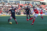 Conor McAleny of Fleetwood Town (right) shoots during the Sky Bet League 1 match between Fleetwood Town and MK Dons at Highbury Stadium, Fleetwood, England on 24 February 2018. Photo by David Horn / PRiME Media Images