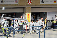 Crew members of Lewis Hamilton (44) scamper towards the wall as 2014 Formula 1 United States Grand Prix comes to an ends, Sunday, November 02, 2014 in Austin, Tex. (Mo Khursheed/TFV Media via AP Images)