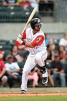 Arkansas Travelers third baseman Brian Hernandez (12) at bat during a game against the San Antonio Missions on May 24, 2014 at Dickey-Stephens Park in Little Rock, Arkansas.  Arkansas defeated San Antonio 4-2.  (Mike Janes/Four Seam Images)