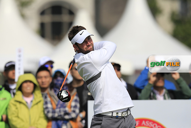 Scott Jamieson (SCO) tees off the 1st tee to start his match during Saturday's Round 3 of the 2013 BMW Masters presented by SRE Group held at Lake Malaren Golf Club, Shanghai, China. 26th October 2013.<br /> Picture: Eoin Clarke/www.golffile.ie