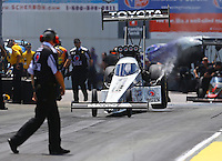Jun 6, 2016; Epping , NH, USA; NHRA top fuel driver Antron Brown does a burnout during the New England Nationals at New England Dragway. Mandatory Credit: Mark J. Rebilas-USA TODAY Sports