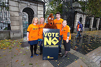 NO REPRO FEE. 24/10/2011. VOTE NO TO 30TH AMENDMENT. Protesters in Kangaroo outfits (keeping with the 'Kangaroo courts' theme of the campaign) are pictured outside Leinster House on Kildare Street Dublin handing out referendum leaflets. learn more at www.kangaroocourts.net. for more information please contact Walter Jayawardene.Irish Council for Civil Liberties.Tel. + 353 1 799 4503 Mob: +353 87 9981574 E-mail  walter.jayawardene@iccl.ie  Picture James Horan/Collins Photos