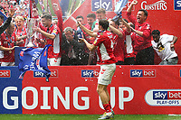 Charlton Manager, Lee Bowyer, covers his face after being sprayed with champagne by Krystian Bielik as Charlton celebrate promotion to the Championship during Charlton Athletic vs Sunderland AFC, Sky Bet EFL League 1 Play-Off Final Football at Wembley Stadium on 26th May 2019