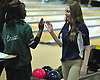 Katie LoPiccolo of St. John the Baptist High School, right, gets congratulated after knocking down pins in the Nassau-Suffolk CHSAA girls' bowling individual championship at AMF Babylon Lanes on Thursday, Feb. 11, 2016. She won the league title with a 565 three game series and had a high game of 206.