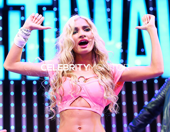 UNIVERSAL CITY, CA, USA - APRIL 19: Singer Pia Mia (Pia Mia Perez) performs at the Universal CityWalk 'Spring Concert Series' Presented By AMP 97.1 Radio held at 5 Towers Outdoor Concert Arena at Universal CityWalk on April 19, 2014 in Universal City, California, United States. (Photo by Xavier Collin/Celebrity Monitor)
