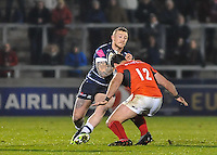 Sale Sharks Josh Charnley tackled by Saracens No 12 and captain Brad Barritt during the European Rugby Champions Cup match between Sale Sharks and Saracens at AJ Bell Stadium, Salford, England on 18 December 2016. Photo by Paul Bell.