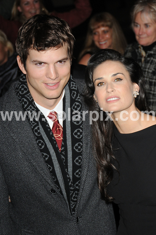 **ALL ROUND PICTURES FROM SOLARPIX.COM**.**WORLDWIDE SYNDICATION RIGHTS**.'Flawless' Film Premiere Reception in aid of CLIC Sargent, held at the Odeon Covent Garden, London, UK. 25th November 2008..This pic: Ashton Kutcher and Demi Moore..JOB REF: 7903 BTT     DATE: 26_11_2008.**MUST CREDIT SOLARPIX.COM OR DOUBLE FEE WILL BE CHARGED* *UNDER NO CIRCUMSTANCES IS THIS IMAGE TO BE REPRODUCED FOR ANY ONLINE EDITION WITHOUT PRIOR PERMISSION*