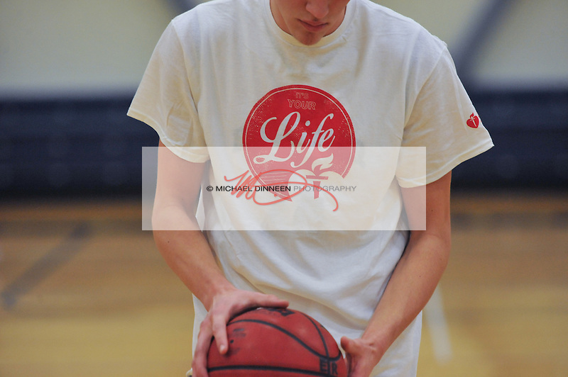 The basketball games between Eagle River and Chugiak were a fundraiser for the American Heart Association. T-Shirts promoting the event were sold and worn by the teams in warmups. Eagle River High School is the leading donor high school in the state. Photo for the Star by Michael Dinneen.