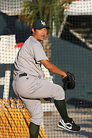 Chi-Hung Cheng of the Lynchburg Hillcats throwing in the bullpen before a game against the Myrtle Beach Pelicans on April 28, 2009