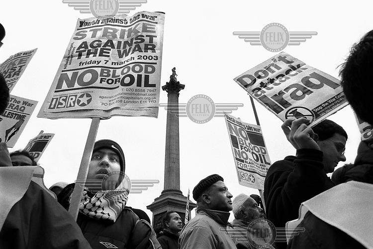 British-Asians protest with placards reading ''No blood for oil' and 'Don't attack Iraq' in Trafalgar Square, during a demonstration against the impending war in Iraq.  Over one million potesters attended the march, which is recognised as being the largest demonstration in British political history.