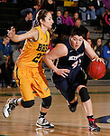 JANUARY 31, 2015 -- Emily Hartegan #41 of Metro State drives on Bailey Kusser #23 of Black Hills State during their Rocky Mountain Athletic Conference women's basketball game Saturday evening at the Donald E. Young Center in Spearfish, S.D.  (Photo by Dick Carlson/Inertia)