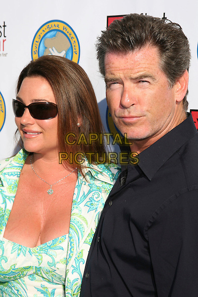 "KEELY SHAYE SMITH & PIERCE BROSNAN .First Star's ""Celebration For Children's Rights"" Benefit, Santa Monica, California, USA..June 3rd, 2006.Photo: Byron Purvis/AdMedia/Capital Pictures.Ref: BP/ADM.headshot portrait sunglasses shades married husband wife.www.capitalpictures.com.sales@capitalpictures.com.© Capital Pictures."