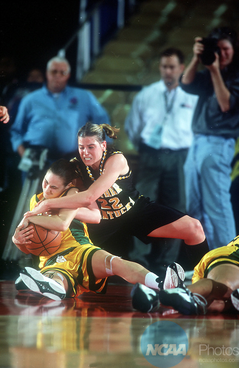 25 MAR 2000:  Amanda Gehrke (23) of North Dakota State holds tight to the ball as Michelle Cottrell (22) tries to pry it loose during the Division II Women's Basketball Championship held at the Pine Bluff Convention Center in Pine Bluff, AR. Northern Kentucky defeated North Dakota 71-62. Tom Ewart/NCAA Photos.
