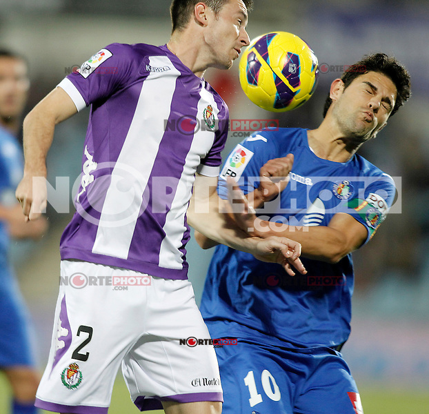 Getafe's Jaime Gavilan (r) and Real Valladolid's Antonio Rukavina during La Liga match.November 18,2012. (ALTERPHOTOS/Acero) NortePhoto