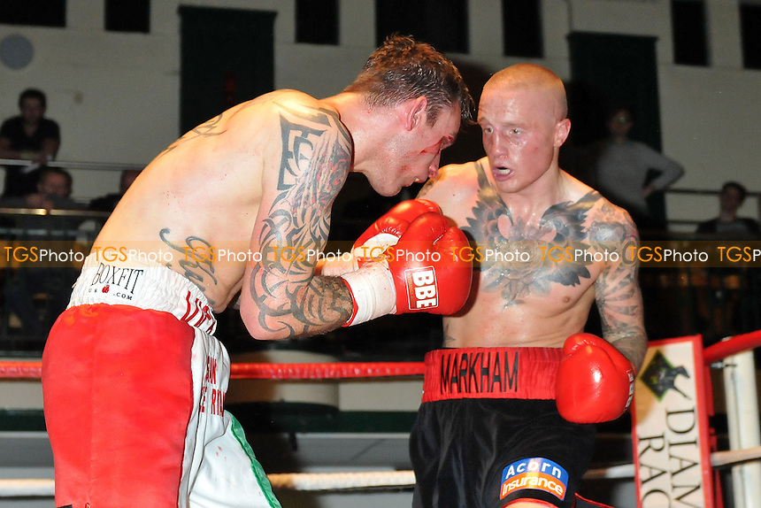 Lee Markham (black/red shorts) defeats Sam Couzens in a Super-Middleweight boxing contest for the British Masters Title at York Hall, Bethnal, Green London - 08/12/13 - MANDATORY CREDIT: Philip Sharkey/TGSPHOTO - Self billing applies where appropriate - 0845 094 6026 - contact@tgsphoto.co.uk - NO UNPAID USE