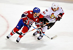 17 October 2009: Montreal Canadiens left wing forward Mike Cammalleri skates close to Ottawa Senators right wing forward Jonathan Cheechoo at the Bell Centre in Montreal, Quebec, Canada. The Senators defeated the Canadiens 3-1. Mandatory Credit: Ed Wolfstein Photo