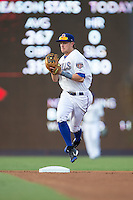 Durham Bulls shortstop Taylor Motter (11) fields a ground ball during the game against the Indianapolis Indians at Durham Bulls Athletic Park on August 4, 2015 in Durham, North Carolina.  The Indians defeated the Bulls 5-1.  (Brian Westerholt/Four Seam Images)