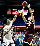 UNCASSVILLE, CT-031818JS02- Sacred Heart's Connor Tierney (0) puts up a shot over Notre Dame-Fairfield's Noreaga Davis (10)during their Division I championship game Sunday at Mohegan Sun Arena. <br /> Jim Shannon Republican-American