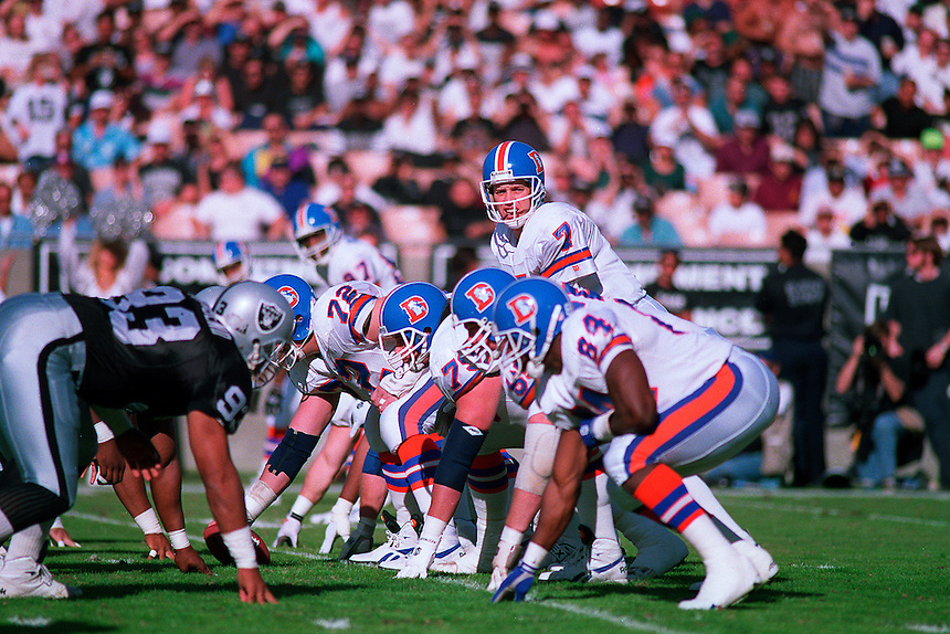 Hall of Fame quarterback John Elway of the Denver Broncos plays in an NFL game against the Los Angeles Raiders in the Los Angeles Coliseum in 1993.