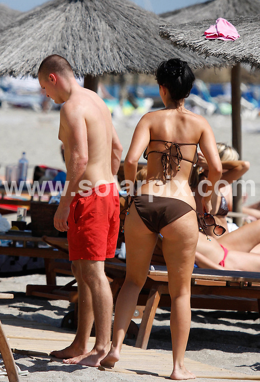 "**ALL-ROUND EXCLUSIVE PICTURES FROM SOLARPIX.COM**.**WORLDWIDE SYNDICATION RIGHTS**.Jennifer Metcalfe, who plays McQueen sister Mercedes Fisher in Hollyoaks, shows off her new boyfriend, William Rodgers on a romantic weekend break in Marbella, Spain. The couple laughed and joked as they relaxed on a sun bed by the sea looking very much in love..An onlooker said they looked absolutely besotted with each other..When asked, Jennifer said: ""It's early days but yes, I do have a new bloke. He's lovely and is making me very happy, but it's very casual at the moment. He's not famous, he's an ordinary man."".Jennifer - who has previously dated soccer star Jermaine Pennant and former 'Big Brother' contestant Ziggy Lichman, insists she prefers dating men who are out of the spotlight..She added: ""I don't see men as celebs and non-celebs but it's easier to be with someone if they're not in the public eye, as you can escape it."".JOB REF:    9978   AB1       DATE:  20.09.09.**MUST CREDIT SOLARPIX.COM OR DOUBLE FEE WILL BE CHARGED**.**MUST AGREE FEE BEFORE ONLINE USAGE**.**CALL US ON: +34 952 811 768 or LOW RATE FROM UK 0844 617 7637**"