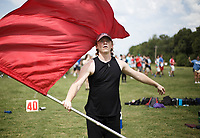 NWA Democrat-Gazette/CHARLIE KAIJO U of A student Shane Vaughn, 19, of Fayetteville practices color guard during a band practice, Monday, August 6, 2018 at Rogers High School in Rogers. He attended the practice to help the school's color guard members.<br />