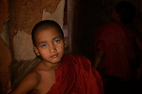 Novice Monks from the nearby Monastery at the the hidden Thameewhetumin cave temple Bagan, Myanmar, Burma.