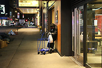 NEW YORK, NY - MARCH 19:  A homeless man stands still at one of the McDonald's entrances at night as the city struggles to curb the number of coronavirus cases on March 19, 2020 in New York City. Gov Cuomo has ordered nonessential businesses in the state to close by 8 p.m. Sunday as more than 11,000 confirmed cases and 56 deaths. (Photo by Pablo Monsalve / VIEWpress via Getty Images)