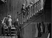 Playing on the stairs in the main hall, Summerhill school, Leiston, Suffolk, UK. 1968.