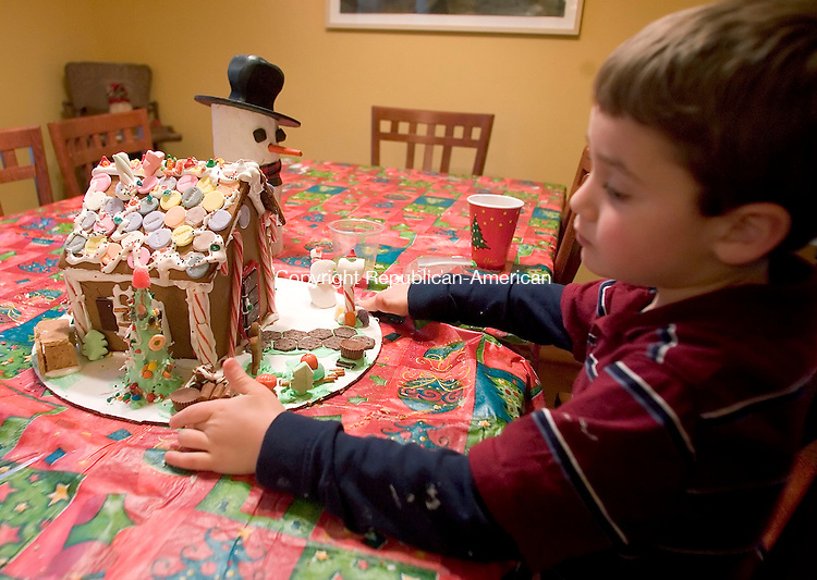 TORRINGTON, CT- 10 DEC 06- 121006JT09- <br /> Daniel Petricone, 5, prepares to bring home his finished gingerbread house after a house making class at Cuisine with Jill Nicolson in Torrington on Saturday. <br /> Josalee Thrift Republican-American