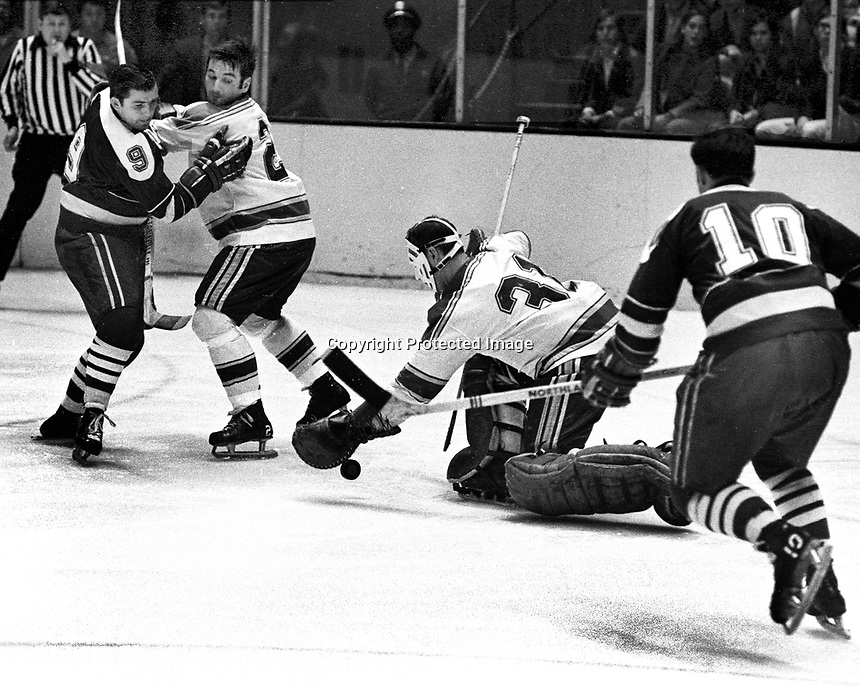 Seals vs. St.Louis Blues (Mar 28,1970)Seals Bill Hicke, and Ted Hampson, #2 Ray Fortin and goalie Ernie Wakely. (Ron Riesterer/photo)