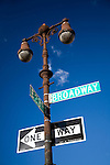 Typical New Yorker street and traffic signs on Broadway, NYC, USA.