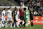 30 September 2015: Referee Ted Unkel (in red) shows a yellow card to Philadelphia's Michael Lahoud (center, with dreads). The Philadelphia Union hosted Sporting Kansas City at PPL Park in Chester, Pennsylvania in the 2015 Lamar Hunt United States Open Cup Final. The game ended in a 1-1 tie after extra time. Sporting Kansas City won the Championship by winning the penalty kick shootout 7-6.