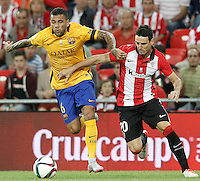 Athletic de Bilbao's Aritz Aduriz (r) and FC Barcelona's Daniel Alves during Supercup of Spain 1st match.August 14,2015. (ALTERPHOTOS/Acero)