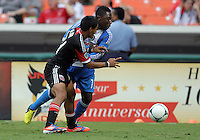 WASHINGTON, D.C. - AUGUST 19, 2012:  Andy Najar (14) of DC United battles for the ball with Freddy Adu (11) of the Philadelphia Union during an MLS match at RFK Stadium, in Washington DC, on August 19. The game ended in a 1-1 tie.