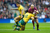Charlie Sharples of England is tackled by Ben Tapuai of Australia during the Cook Cup between England and Australia, part of the QBE International series, at Twickenham on Saturday 17th November 2012 (Photo by Rob Munro)