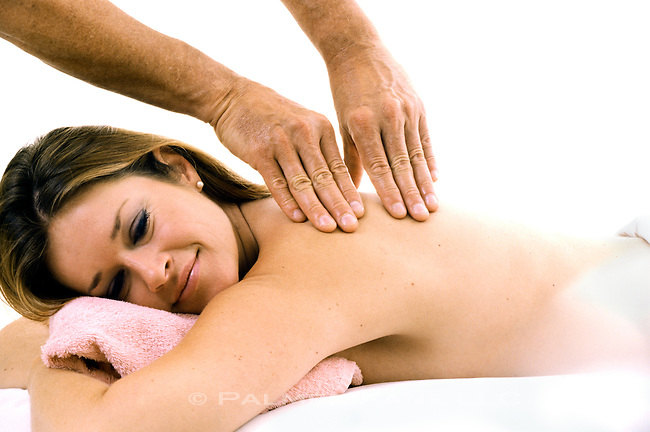 Woman relaxing at a spa getting a massage